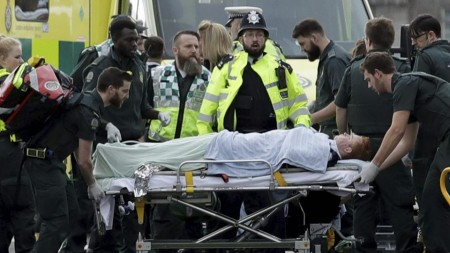London attack toll is four, seven suspects held