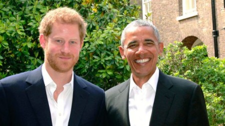 Prince Harry holds Obama at the Kensington Palace