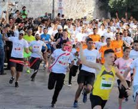 Thousands run for freedom of movement in Palestine marathon